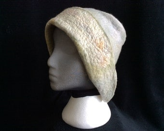 One of a kind handmade wet felted cloche style hat, hand dyed merino wool and silk mawata