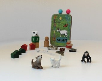 Tiny toys in a wee tin box with dog, cat, and monkey. Fun collection of random toys for kids. Busy box, stocking stuffer, activity tin.