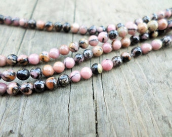 Rhodonite 3mm Rounds 16 Inch Strand