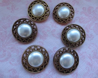 Vintage white faux pearl center gold tone aztec design edge design plastic shank button. Lot of 6 buttons.