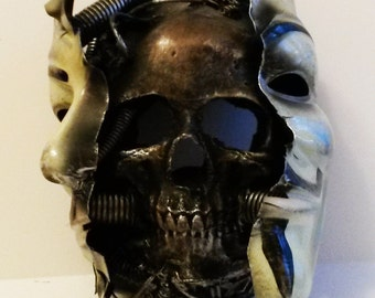 Behind the  v for vendetta mask.