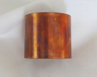 Fun copper cuff with heat patina to bring our colors and shapes