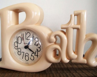 """1970s Ivory Plastic Battery Operated """"Bath"""" Wall Clock"""