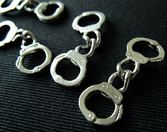 Destash (7) Little Handcuffs - charms for pendants, jewelry making, crafts, scrapbooking