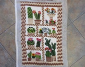 vintage finished needlepoint, cactus patchwork, desert decor, Columbia Minerva,  14 by 22 inches inches. background