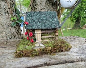 Handcrafted Miniature Log Cabin With Climbing Red Roses