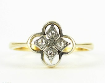 Antique Quatrefoil Design Ring, Four Stone Diamond Ring in Clover or Flower Shape. Circa 1900, 18 Carat Gold.
