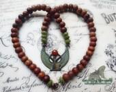 Wings of Isis Sandalwood and Jade gemstone beaded necklace - verdigris patina with carnelian gemstone