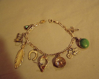Vintage 1960s Sterling Silver Charm Bracelet 9 Charms Roulette Wheel Handcart Feather Gun Holster Bicycle 8366