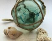 "Japanese Glass Fishing Float - 2.5"" Diameter, Original Net, Painted Symbol on Glass"