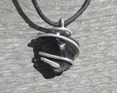 Black Obsidian Pendant...TRIDENT- This Spiral Seed Pendant features a raw piece of Black Obsidian wrapped in Silver wire.