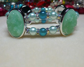 2 Strand bead bracelet  done in different shades of green