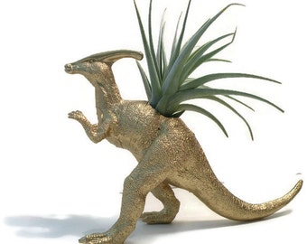 Parasaurolophus dinosaur in gold with large air plant.