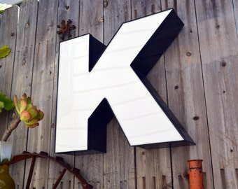Vintage Marquee Sign Letter Capital 'K': Large Black & White Wall Hanging Initial -- Industrial Neon Channel Advertising