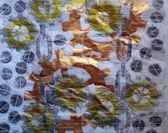 Sheet of white tissue paper printed in metallic Steampunk design