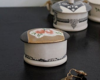 lovely little porcelain jewelry box with roses gold and black patterns