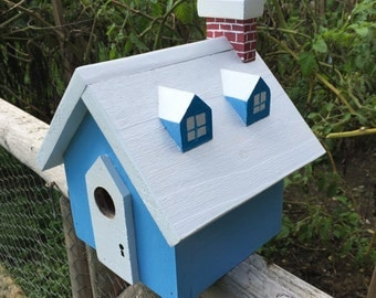 Blue and white wooden birdhouse