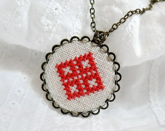 Cross stitch necklace with red diamond shaped embroidery n044