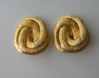 Les Bernard gold plated swirl clip-on earrings.