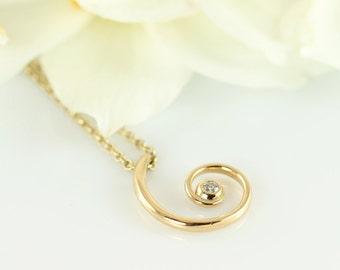 FAUN curly gold pendant with diamond