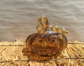 Hand- blown glass pumpkins, made in Corning NY,amber with gold iridescent stem