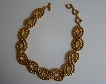 YSL Yves Saint Laurent necklace made with 6 twisted rings