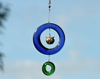 sun catcher from recycled blue and green glass withbrass owl head