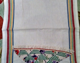 kitchen towel with vintage basket quilt block sewn on