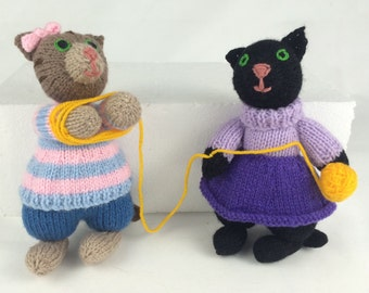 Knitting kitties: winding wool together