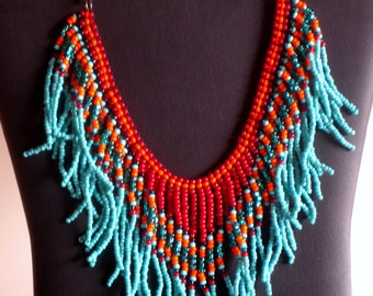 Native American beadweaving necklace in turquoise, teal, dark red and orange