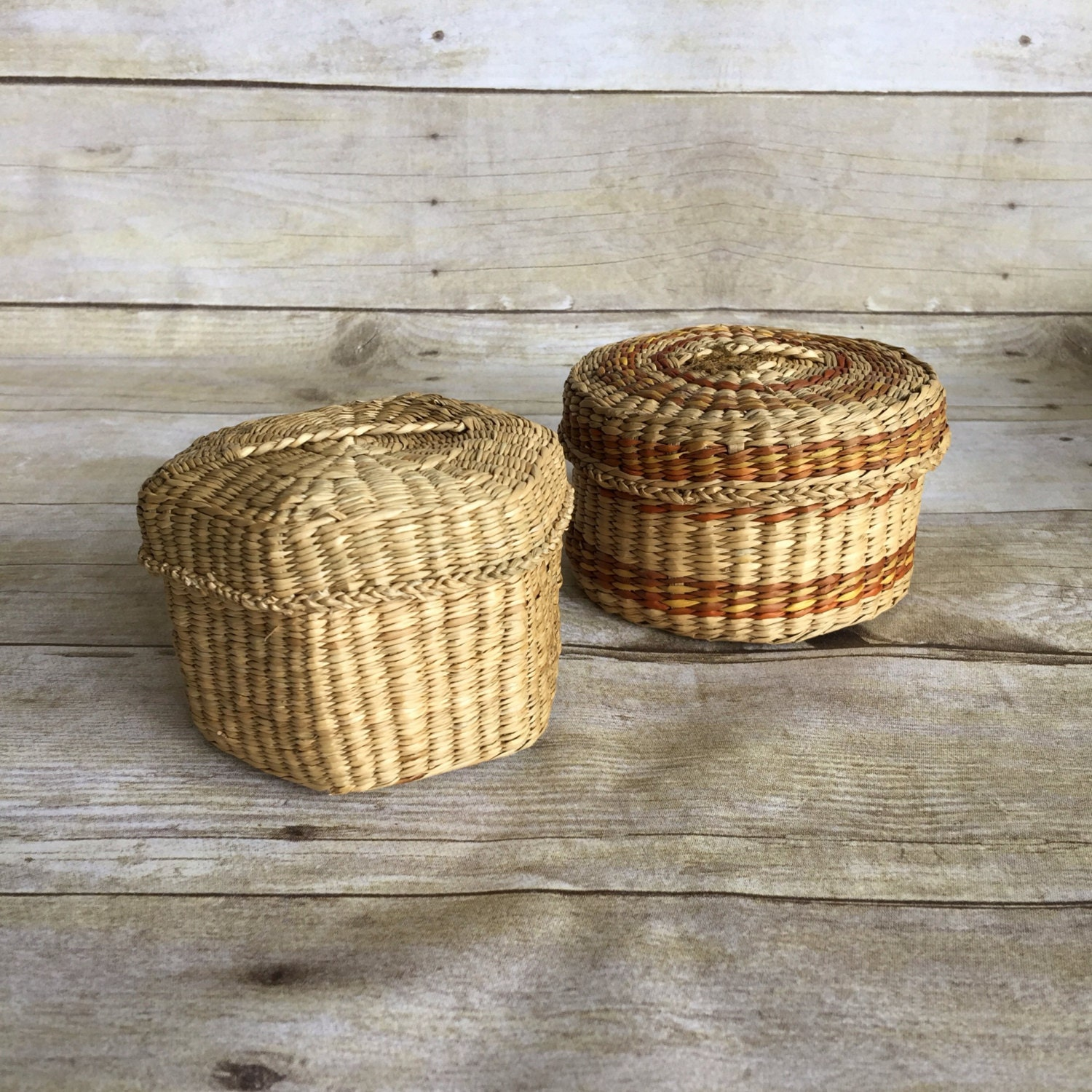 two small woven basket with lids. Black Bedroom Furniture Sets. Home Design Ideas
