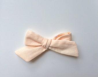 Vintage soft peach dainty bow