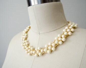 vintage Trifari necklace / cream and gold bib necklace