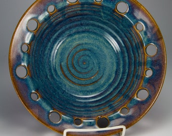 Blue bowl with pierced rim
