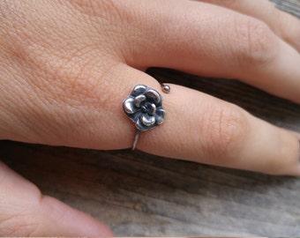 Silver, adjustable flower ring.
