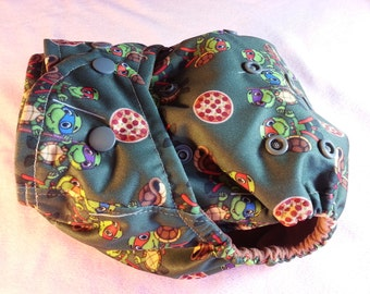 SassyCloth one size pocket diaper with turtle warriors PUL print. Made to order.