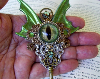 Dragon Eye Brooch (P633) Green Sparkle with Gold Highlight Glass Eye, Brass Pieces, Green Sparkle Wings, Swarovski Crystals, Tie Tacks