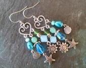 Bohemian beach aqua chandelier earrings, silver beach chandelier earrings with teal glass, pearl, lime green glass starfish, shell and sun