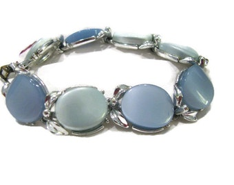 Baby blue and slate blue thermoset link bracelet, no markings found