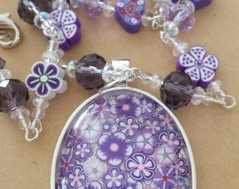 Sale was 24 now 21uk Purple Forget Me Not Floral Faux Mille Fiori Pendant on bead and Flower bead Necklace.