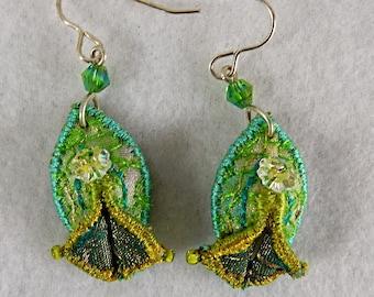 Textile earrings in pale green