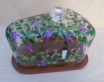 glass and wood covered cheese dish with hand painted grapesvines