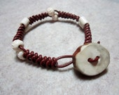 Braided leather bracelet with antler button