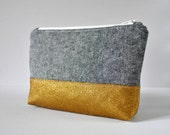 Gold glitter black linen padded toiletry bag cosmetics travel make up pouch in textured black in large.