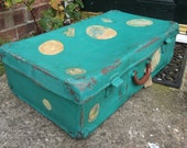 Vintage suitcase hand painted in chalk paint lined inside with vintage books paper.