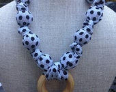 Black and gray teething and breastfeesing necklace