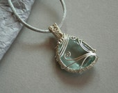 Frozen Sky - blue obsidian with silver plated wire wrapped pendant