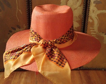 70s large wide brim coral faux straw hat with scarf by Betmar hats New York Paris