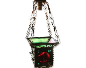Colorful stained glass and jeweled lantern light