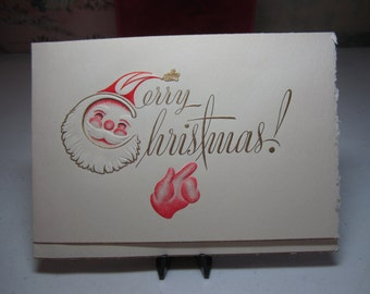 Vintage 1940's-50's deeply embossed gold gilded christmas card with a cute santa face and red mitten graphics